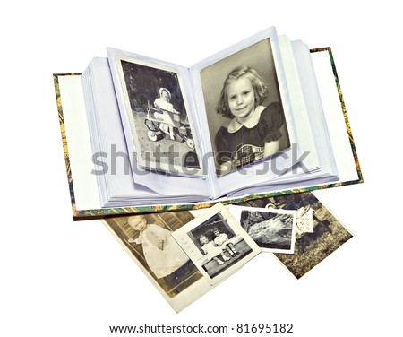 A photo album with old pictures of family members. - stock photo