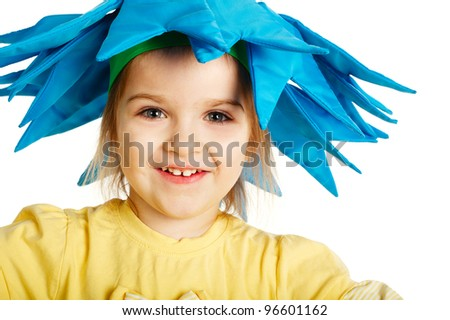 A photo of a Beautiful blond girl with cornflower hat - stock photo