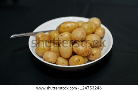 A photo of a bowl of potatoes - stock photo