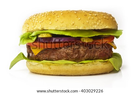 A photo of a burger with leaves of green lettuce, slices of Cheddar cheese, gherkins, red onions, tomatoes, and a thick meat patty, isolated on white - stock photo