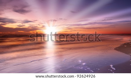 A photo of  a Calm ocean at sunset - stock photo