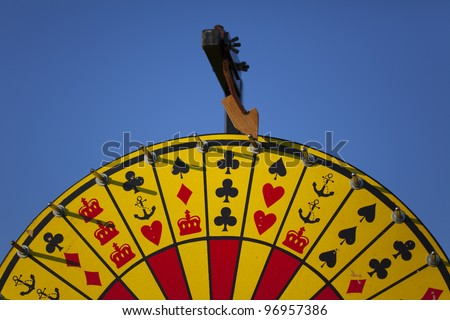 "A photo of a Crown and Anchor ""Wheel of Fortune"" game showing the top half of the wheel. - stock photo"