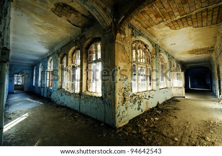 A photo of a derelict hospital corridor - stock photo