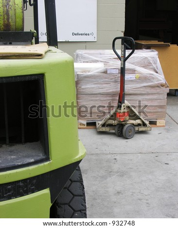 A photo of a forklift and crate next to loading area - stock photo
