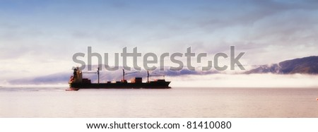 A photo of a huge commercial boat and ferry - stock photo