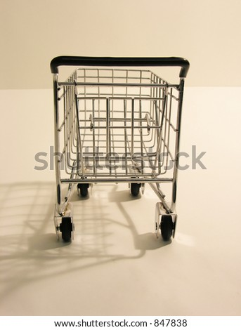 A photo of a miniature shopping cart - stock photo