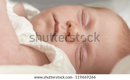 A photo of a newborn baby sleeping