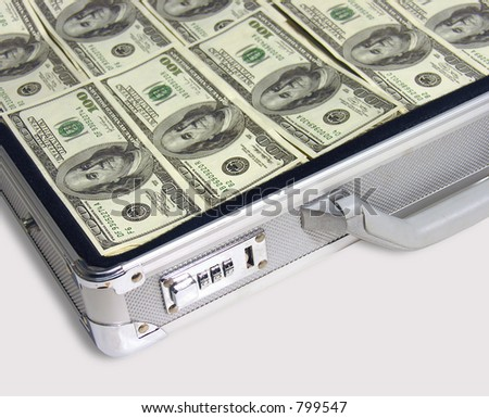 A photo of a suitcase full of cash
