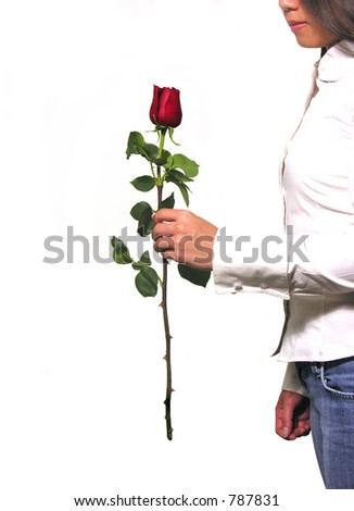 A photo of a woman holding a rose - stock photo