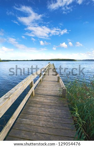 A photo of a wooden jetty and lake - stock photo