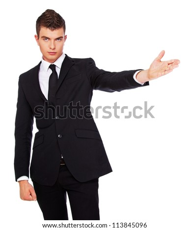 A photo of a young dandy in a black suit - stock photo