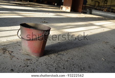 A photo of an abandoned fire bucket - stock photo