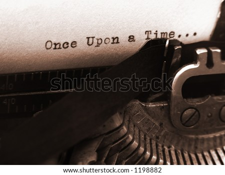 A photo of an old type writer with focus on the text - stock photo
