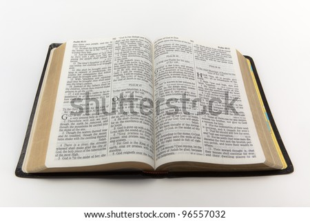 A photo of an open Bible isolated on a white background. - stock photo