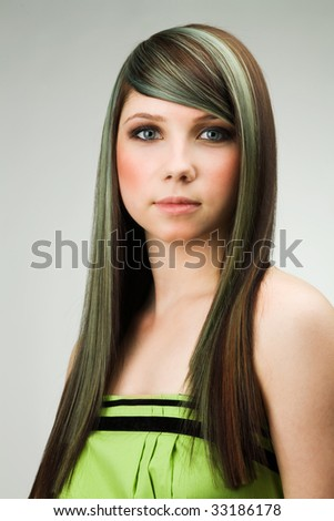 A photo of attractive woman with coloured hairstyle - stock photo