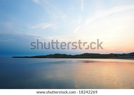 A photo of beach and ocean in sunset - stock photo