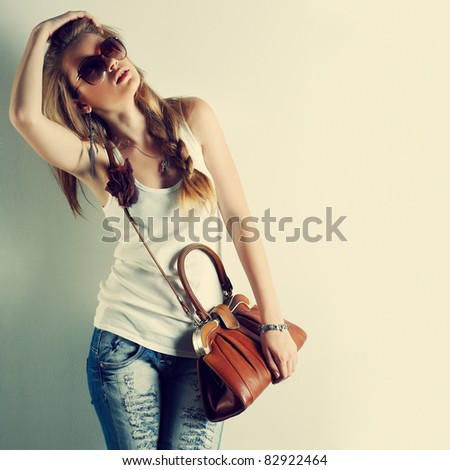 A photo of beautiful girl is in fashion style - stock photo