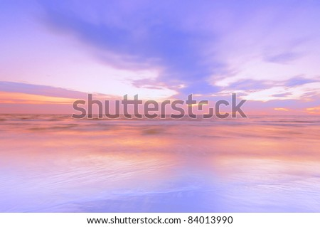a photo of beautiful sunset at the beach - stock photo