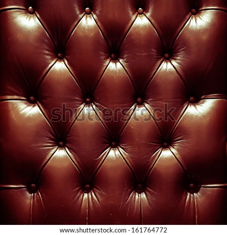 a photo of close up leather upholstery sofa,classic retro - stock photo