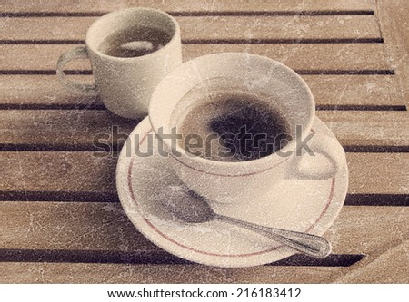 a photo of coffee in cup on wood table with green tea - stock photo