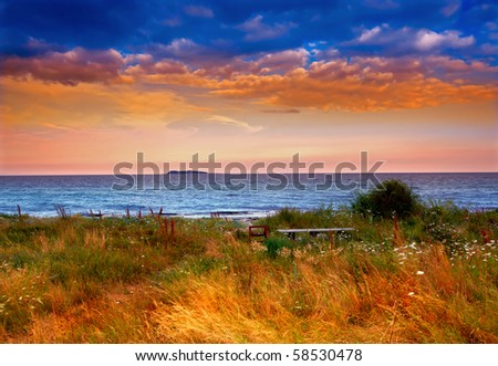 A photo of country sunset by the sea - Denmark - stock photo