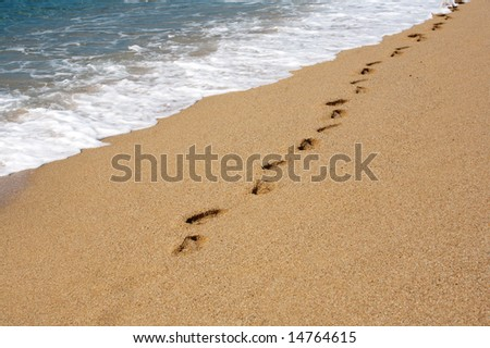 a photo of footprints on the sand - stock photo
