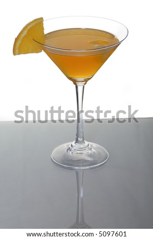 A photo of martini glass with orange cocktail and a piece of citrus