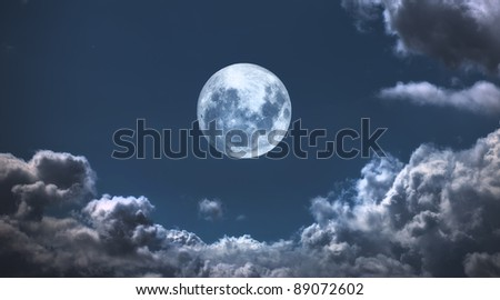 A  photo of moon and clouds - stock photo