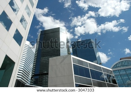 a photo of multiple sky scrapers in downtown denver