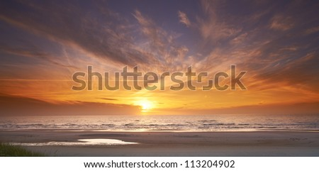 A photo of ocean sunset - Jutland, Denmark - stock photo