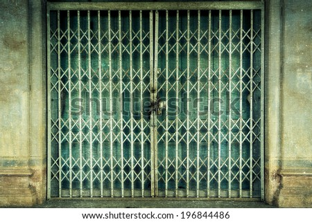 a photo of old front door thai classic , grunge style - stock photo