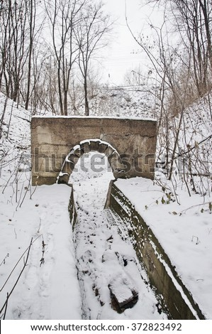 A photo of old stony watercourse in winter forest