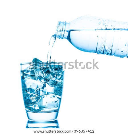A photo of Pouring water into a glass with ice on white isolate background