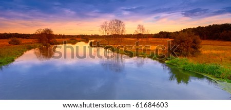 A photo of river sunset late summer - stock photo