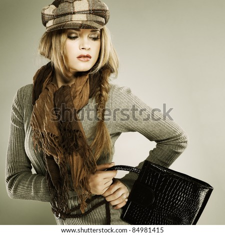 A photo of sexual  beautiful girl is in fashion style with a bag - stock photo