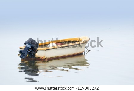A photo of Small boat an early foggy morning - stock photo