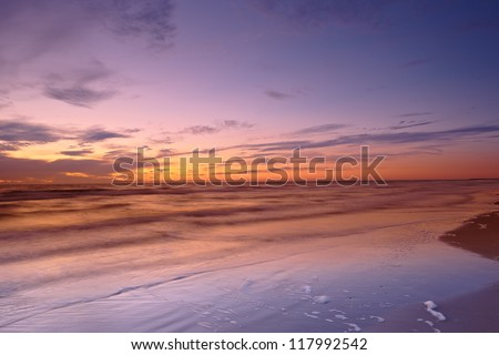 A photo of sunrise at the beach - stock photo