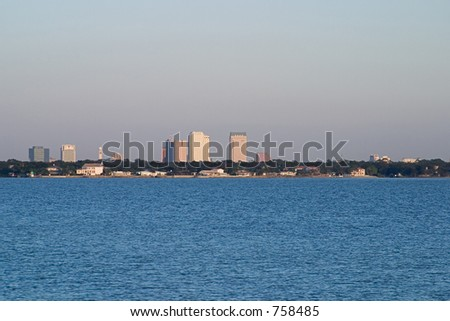 A photo of the Tampa Skyline viewed from across the water of Tampa Bay. - stock photo