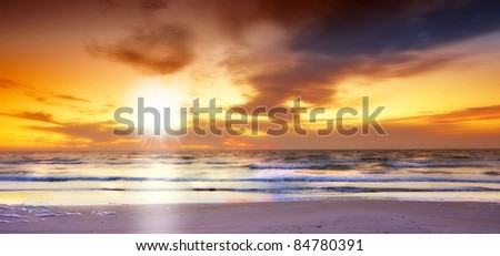 A photo of tropical beach sunset - stock photo