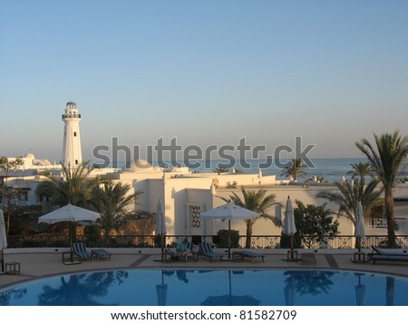 A photo taken across a luxury resort in Egypt at sunset - stock photo