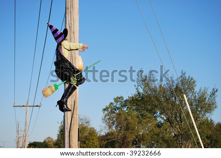 A photograph of a low flying halloween witch crashing into a telephone pole in Oklahoma.