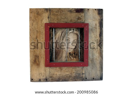 A photograph of a pretty young girl overlaid on real aged and weathered wood.  Generous copyspace. - stock photo