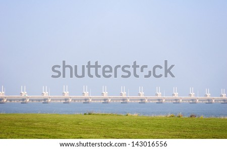 A photograph of part of the famous Dutch Delta Works - the Eastern Schelde storm barrier. - stock photo