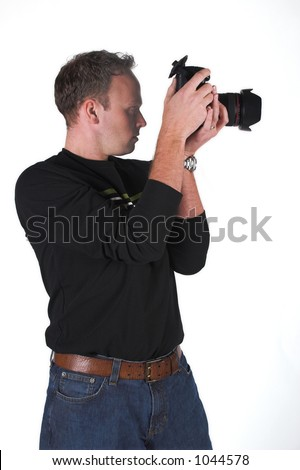 A photographer shoots with his digital SLR camera