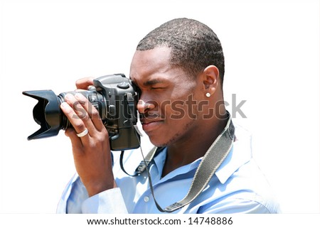 a photographer takes a photo with his digital camera isolated on white
