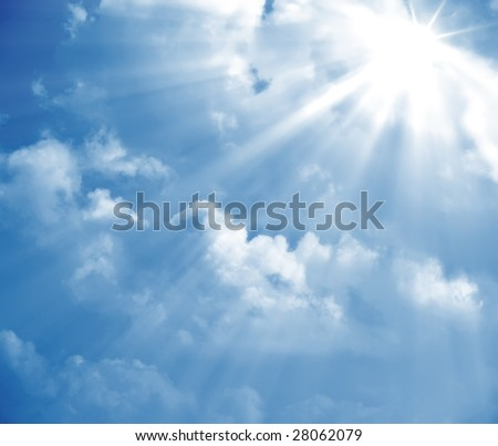 A photography of a blue sky with sun rays - stock photo