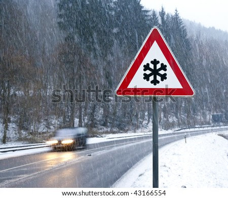 A photography of a snow street sign - stock photo