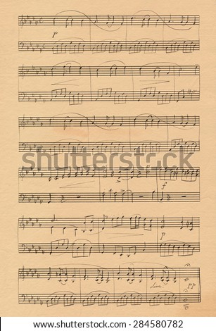 A piano concert for two, sheet music on old paper - stock photo