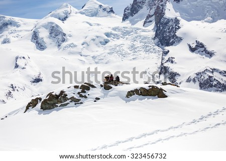 A picnic group with background of snow mountain