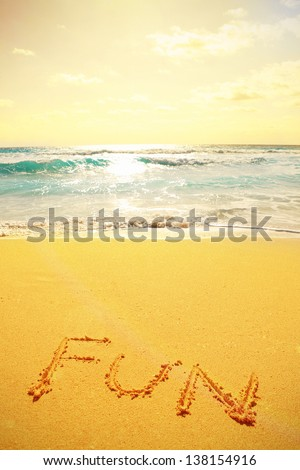 A picture of a beautiful coastline landscape and handwritten text on the sand - stock photo
